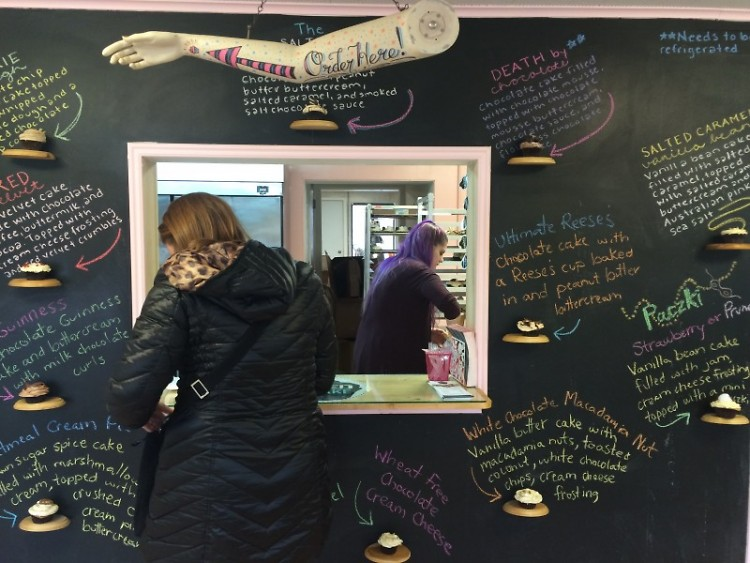 The Salted Cupcake's walk-up window surrounded by the flavors of the day.