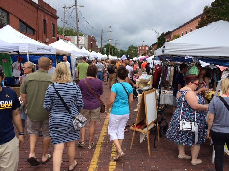 Patrons filled Weatlhy Street between Giddings Avenue and Lake Drive to check out information from nonprofits and art