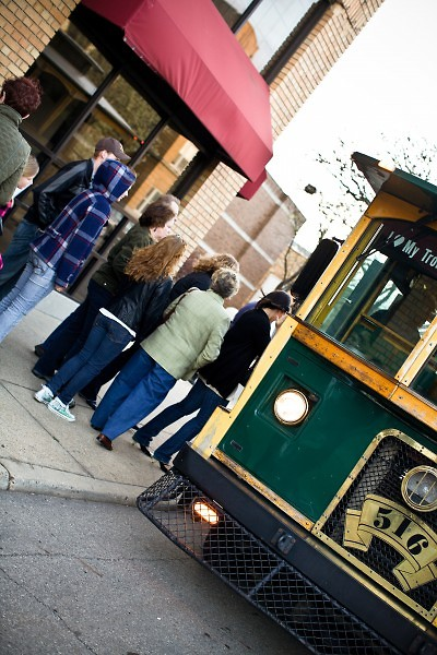 Art.Downtown. visitors embarking on one of the two trolleys