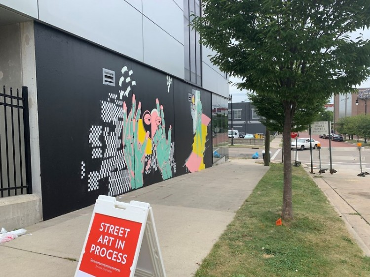 """Love Yourself,"" a new Heartside mural by Bryan Kosciolek, invites passersby to reflect on community self-care"