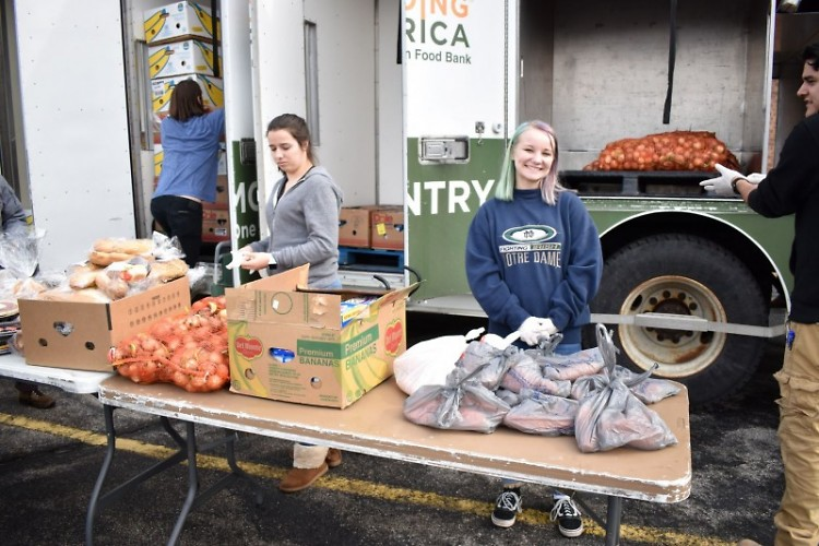 Marissa serves at a Mobile Food Pantry but also receives food for her family.