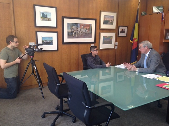 (L to R) Chris Kotcher films cub reporter Edgar and Mayor Heartwell for an upcoming video