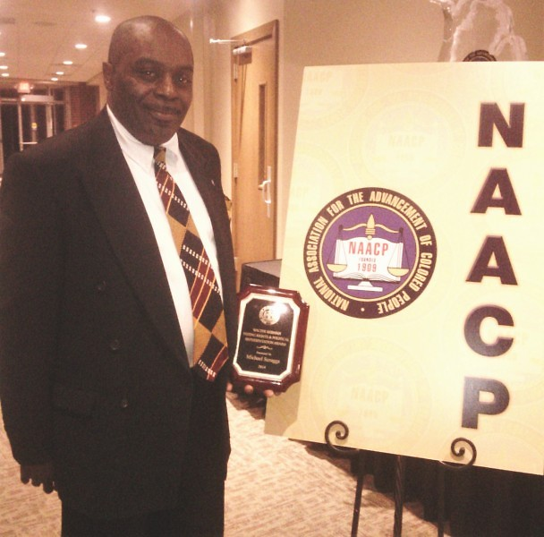 Scruggs receiving the 2014 NAACP Walter Berman Voting Rights & Political Representation award.