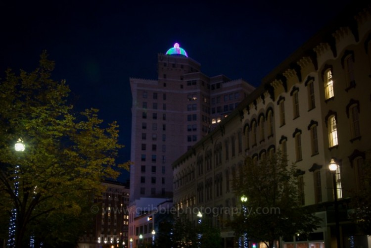 McKay Tower Grand Rapids, lit in green, pink, and teal for MBC awareness