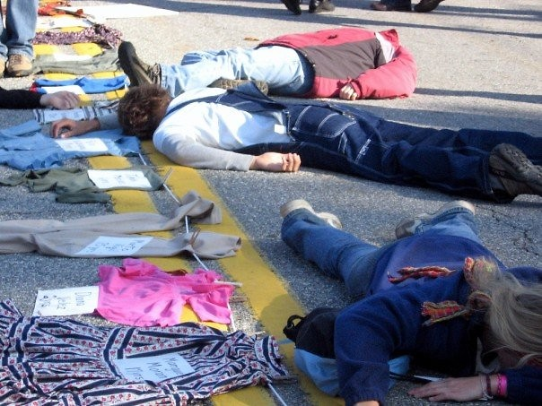The clothing of political unrest victims was laid out on the street while actors played dead to further the scene's impact.