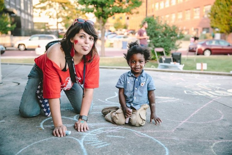 Heartside Downtown Neighborhood Association Co-Chair Alysha Lach-White got chalky with kiddos at 2018's event.