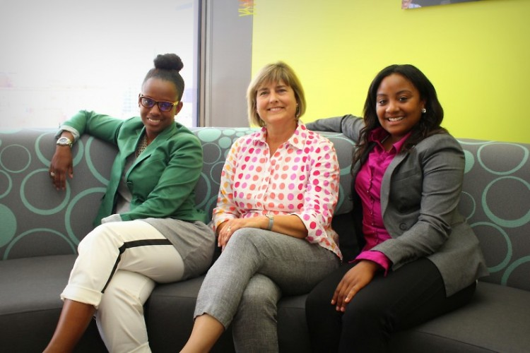 Lynn Heemstra (center) with her now-former teammates, Shannon Harris (left) and Shayla Willis (right); pre-pandemic.