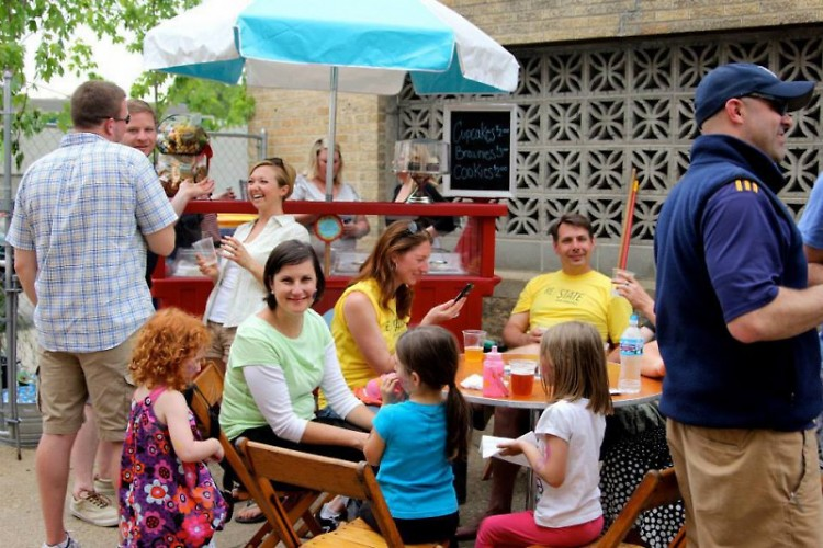 Participants enjoying the afternoon with local food and beer in the Alleyway Café on State St