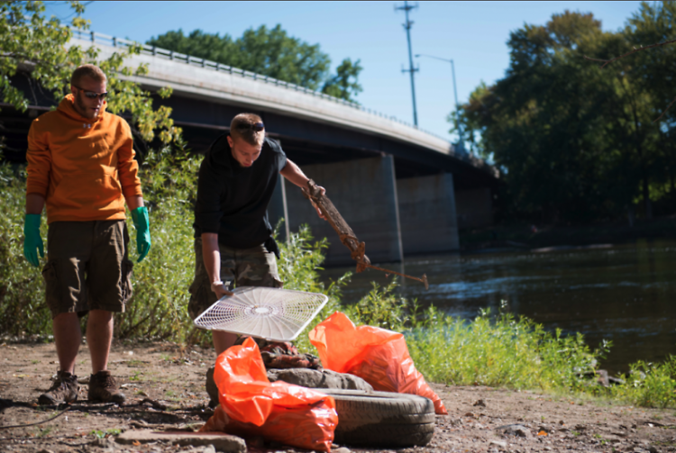 Volunteers work to clean the Grand River