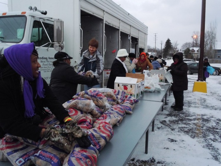 Volunteers unload food at a distribution at Pilgrim Rest Missionary Baptist Church last week.