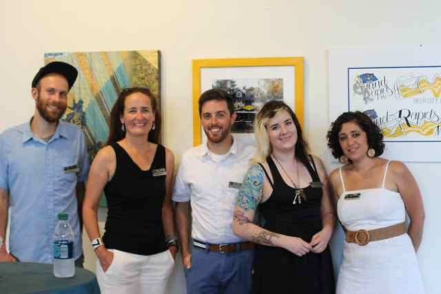 The artists in front of their work at the opening reception.