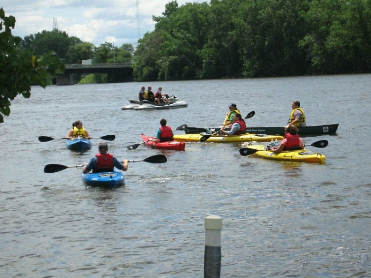 Local citizens kayak in the Grand River with Mayor Heartwell