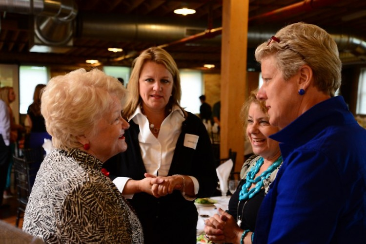 Judge Sara Smolenski, right, talks with guests at the Many Hands Against Hunger fundraising luncheon.