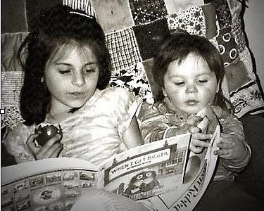 Rebecca and Josh Johnson enjoying reading time together in their great-grandmother's rocking chair, c. 1998
