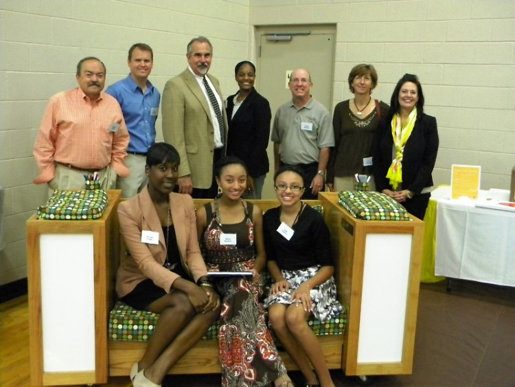 Representatives from Century A&E, GRPS, and United Way's Schools of Hope and Volunteer Center pose with the Reading Corner bench