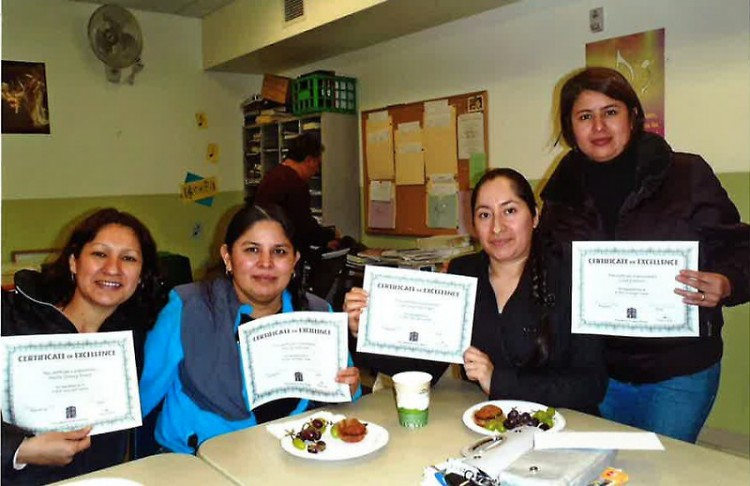ESL students display certificates from their class