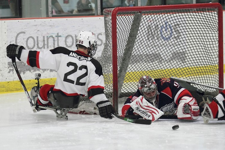 Sled Wing Tyler Anderson tries to score against Griffin Francis Pare during last year's Griffins-Sled Wings game