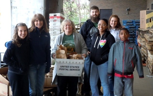 Food Bank staff members and volunteers sort donations at the Kentwood Post Office branch in 2013.