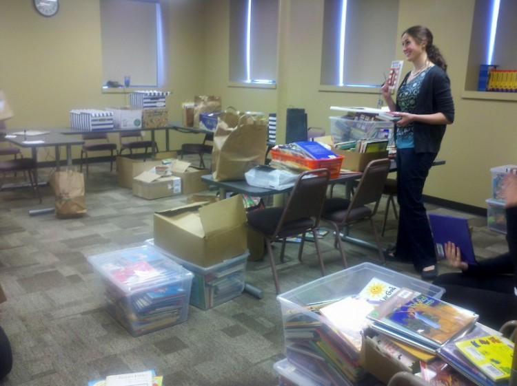Literacy Center staff count and sort books