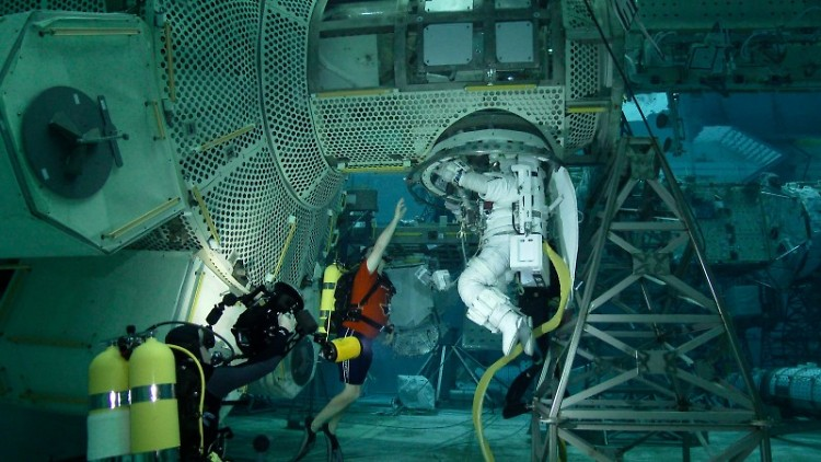 Astronaut training underwater for space conditions.