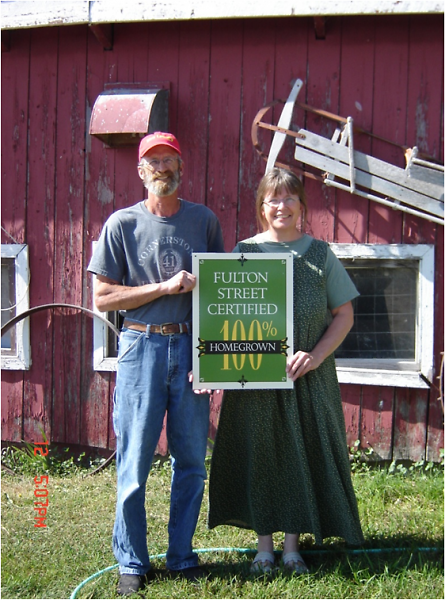 "S&S Lamb with their ""100% Homegrown"" sign"