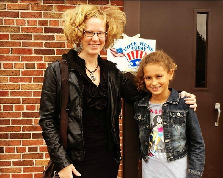 Tami VandenBerg with her daughter, Sylvia Rose VanCarterBerg, going to vote.