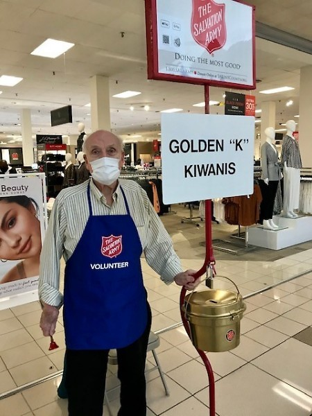 "Golden ""K"" Kiwanians compete for the Golden Ketlle Award. As current champs, a golden kettle is used for donations."