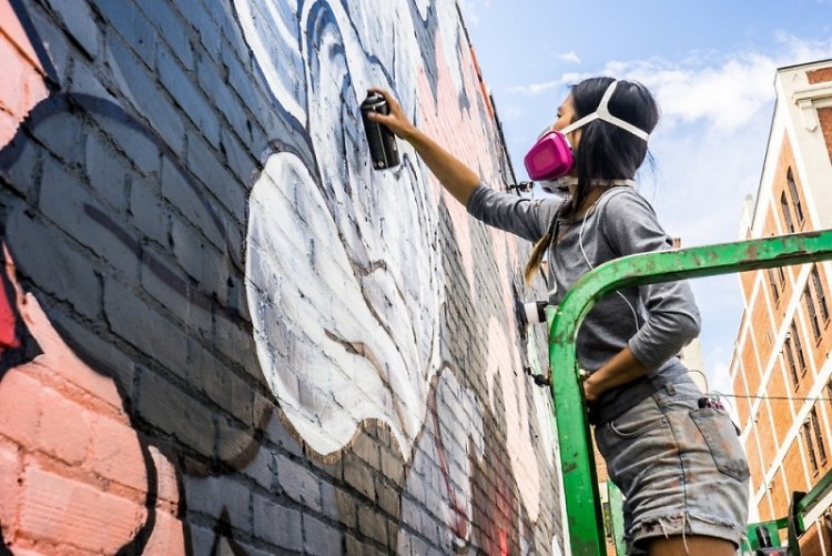 Artist Louise 'Ouizi' Chen painting the new mural