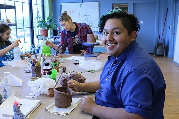WMCAT teenage student, Juan, practicing his ceramic skills within the pottery studio.