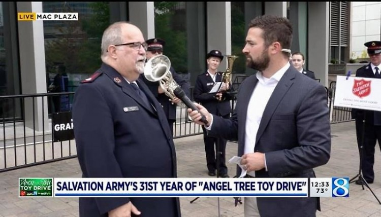 WOOD8 TV interviews Major Glen Caddy at the start of the Angel Tree Toy Drive.
