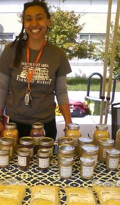 Market manager Christina Flier and some of the items available for direct purchase.