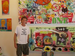 Reb Roberts of Sanctuary Folk Art in front of a recent collaboration