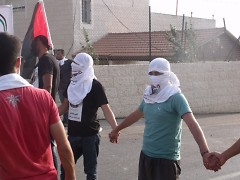 A group of Palestinian demonstrators lined up before an International Peace Day demonstration.
