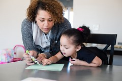 Connections mother completing a developmental screening with her daughter