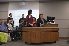 Angelica Velazquez, owner of La Casa de Cobija, speaking at the City Commission meeting with translation from Allison Colberg