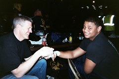 Coach Dennis Shimmell Jr. of MGGA, wrapping the hands of 201+ Novice Champion, Cameron Glenn