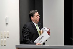 Greg Sundstrom all smiles as he departs last City Meeting