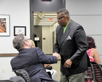 Commissioner Moody shaking hands with a fellow candidate after being appointed to the Grand Rapids Commission