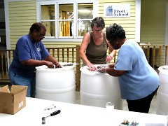 Participants learned how to save on water bills and care for the environment at a Fix-It School rain barrel workshop.