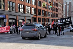 Protesters block traffic on their mach to Rosa Parks Circle.