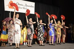 A fashion show featuring Asian customs style of dress closes out the celebration