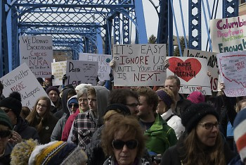 Marching for Our Lives marchers crossing the Blue Bridge