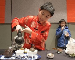 Andrew Wu pours tea he made at the Chinese New Year Celebration