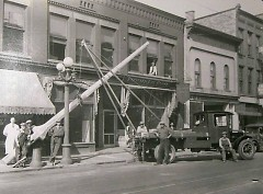 A crew from the street lighting dept. is shown installing a new light on the west side of Division just south of Fulton in 1928.