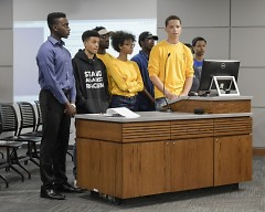 NAACP youth speak to the city commission on policing issues.