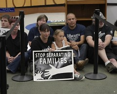 Protesters sit in after public comment at Kent County Commission