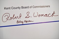 Signatures of Commissioners Womack and Melton on the contract from Cosecha GR