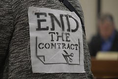 """""""End the Contract"""" print on a GR Rapids Response to ICE member giving public comment"""
