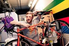 "Daniel Koert at his bicycle shop, <a href=""http://www.facebook.com/pages/Grand-Rapids-MI/Commute-GR/107259887928"">CommuteGR</a>."