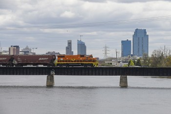 Freight train traveling west across the Grand River in Grand Rapids, MI.